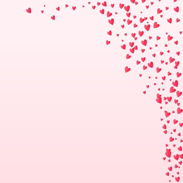 バレンタイン紙吹雪心背景に落ちる Premiumベクター