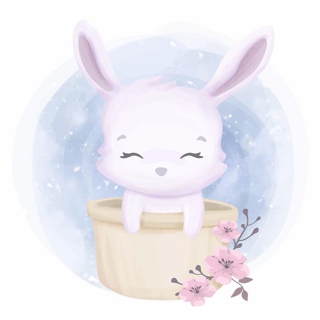 バケツにかわいい動物の小さなウサギ Premiumベクター
