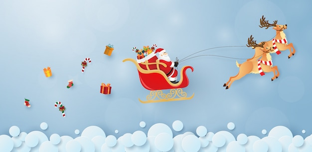サンタクロースとトナカイが空を飛んで Premiumベクター