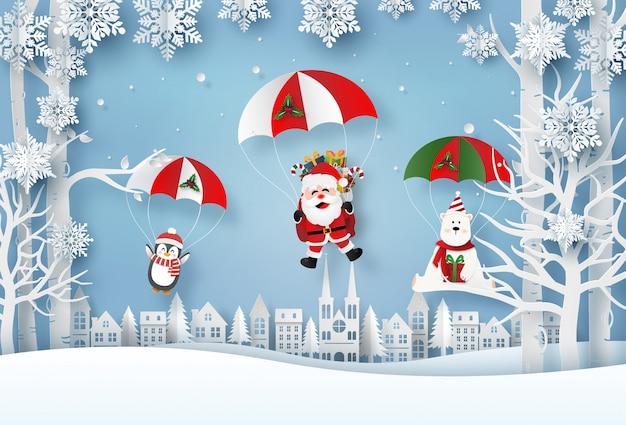 サンタクロースとクリスマスキャラクターが村でパラシュートジャンプをし、 Premiumベクター