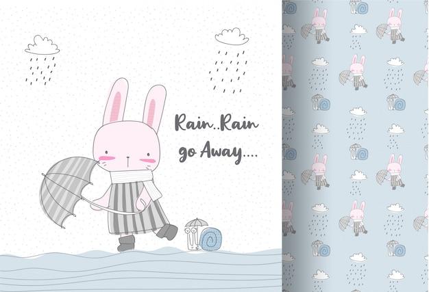雨のシームレスなパターンでかわいいウサギ Premiumベクター