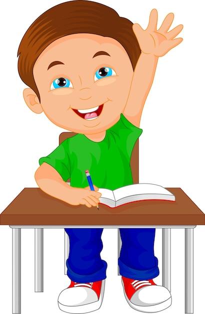 テーブルの上に座っている学校の男の子 Premiumベクター