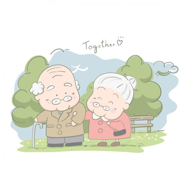 年配のカップルが公園で一緒に歩いて Premiumベクター
