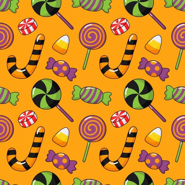 幸せなハロウィーンのシームレスパターンとオレンジ色で分離された漫画キャンディー Premiumベクター