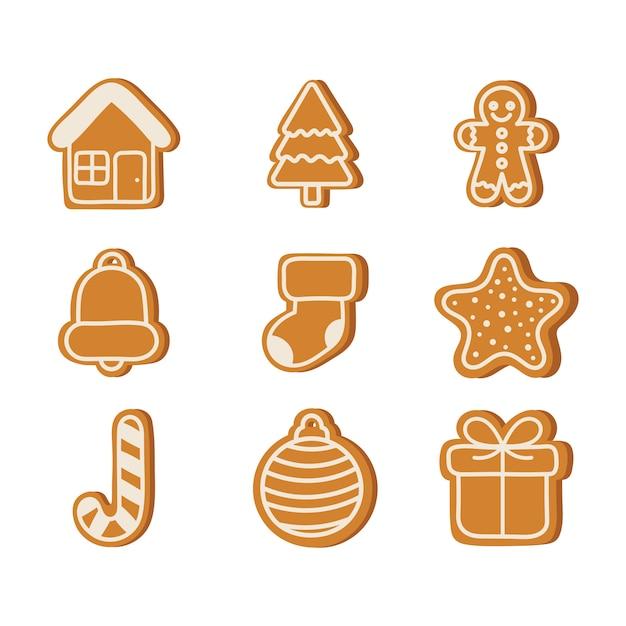 ジンジャーブレッドクッキーは、白で隔離されるクリスマスを設定します。 Premiumベクター