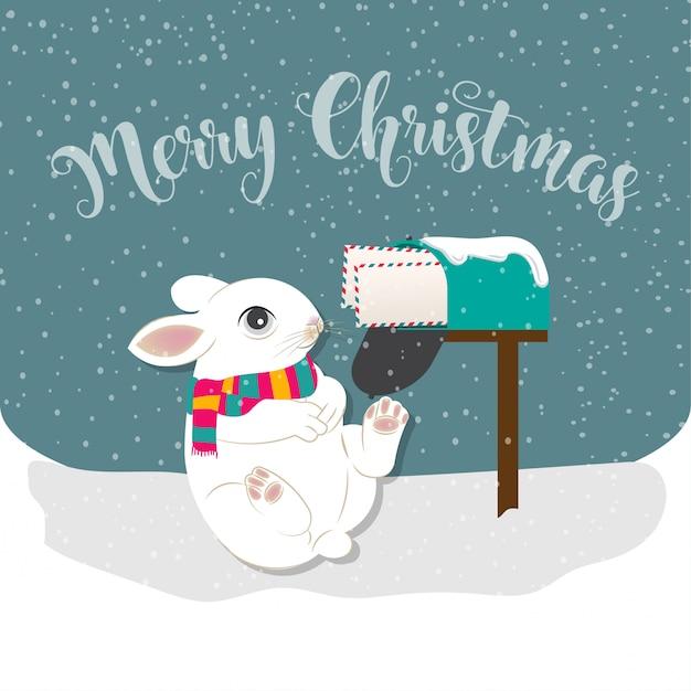 ウサギとポストでメリークリスマスのグリーティングカード Premiumベクター