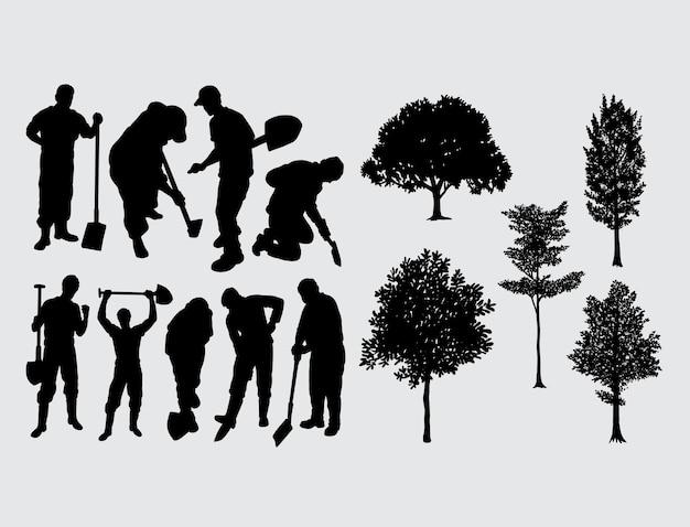 掘る労働者と木のシルエット Premiumベクター