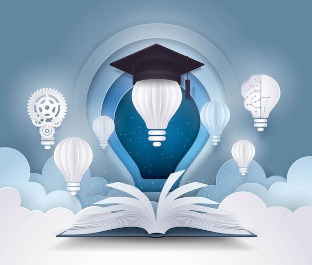 電球と卒業の帽子、大学教育の概念と本を開く Premiumベクター
