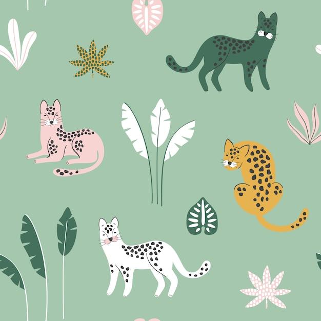 Бесшовный узор с леопардами и тропическими листьями. Premium векторы