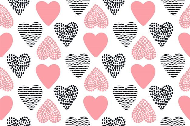 手でシームレスパターンには、バレンタインの心が描かれています。 Premiumベクター