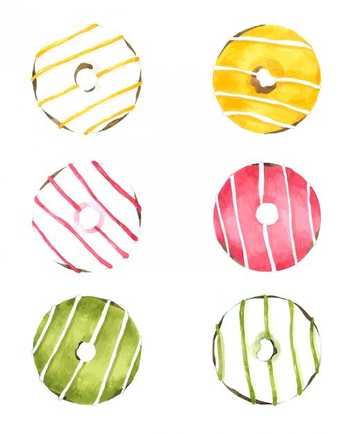 Рисованные акварельные пончики Premium векторы