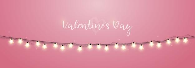 ピンクの背景にお祝いのスパークリングライトガーランド。 Premiumベクター