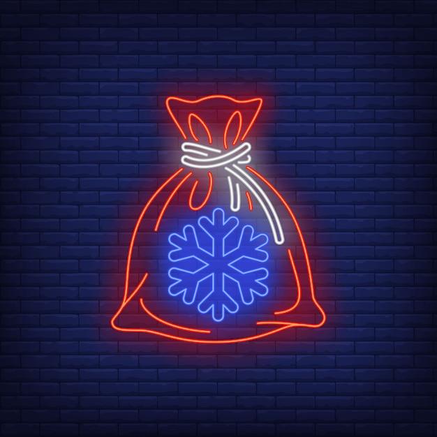 ネオンスタイルのクリスマスギフト袋 無料ベクター