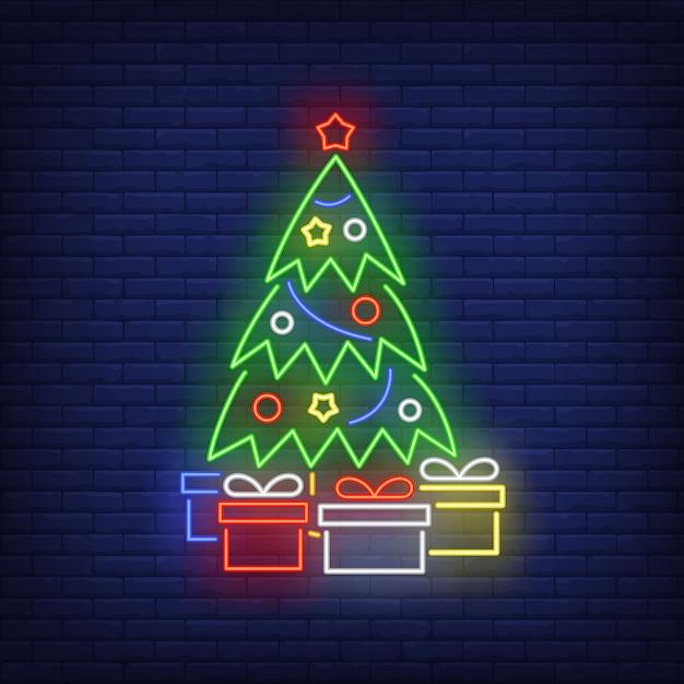 クリスマスツリーとネオンスタイルのギフト 無料ベクター