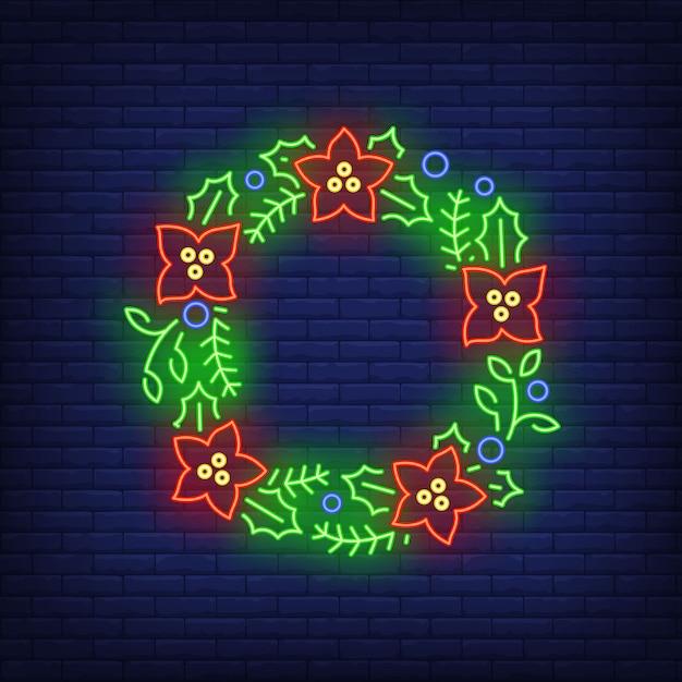 ネオンスタイルの赤い花と緑のクリスマスリース 無料ベクター