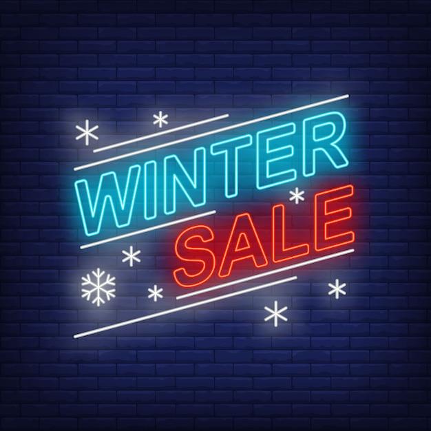 Зимняя распродажа баннеров и снежинок в неоновом стиле Бесплатные векторы