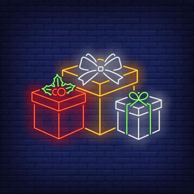 Рождественские подарки в неоновом стиле Бесплатные векторы