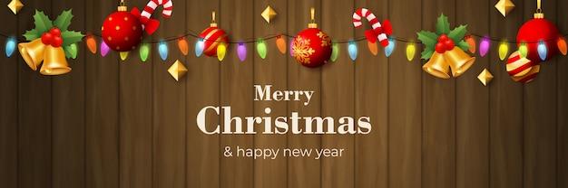 Счастливого рождества баннер с гирляндой на коричневой деревянной земле Бесплатные векторы