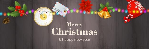 Счастливого рождества баннер с гирляндой на сером деревянном фоне Бесплатные векторы
