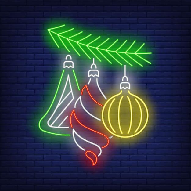 Рождественские шары на елке ветви неоновая вывеска Бесплатные векторы