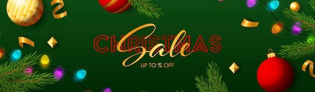 Рождественская распродажа баннер со сверкающими разноцветными лампочками Бесплатные векторы