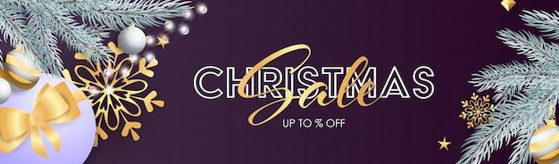Рождественская распродажа баннер со сверкающими серебряными лампочками Бесплатные векторы
