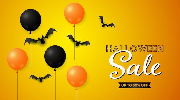 Хэллоуин распродажа баннер с летучими мышами и воздушными шарами Бесплатные векторы