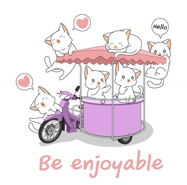 可愛い猫が携帯屋台のオートバイで Premiumベクター