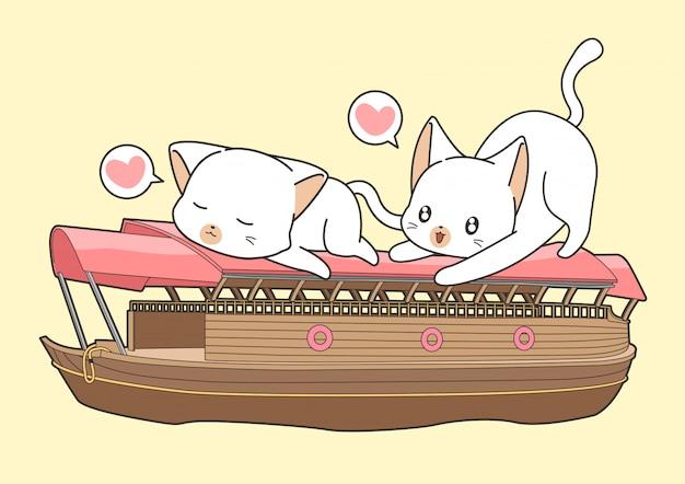 Очаровательные кошки на лодке Premium векторы