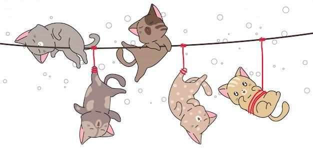 Очаровательные кошки были повешены на веревке Premium векторы