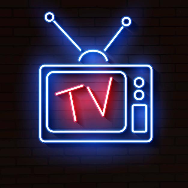 レンガの壁にアンテナを持つ古いネオンテレビ Premiumベクター