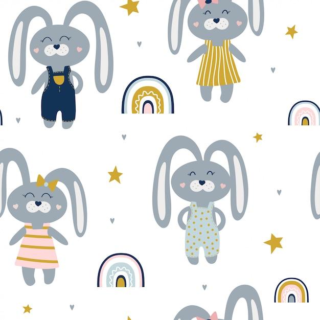 Симпатичные бесшовные модели с зайцами и радугами. Premium векторы