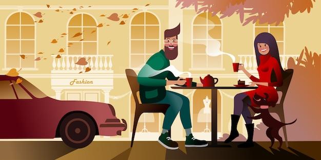 シティカフェの秋のテラスでお茶を飲む若いカップル。都市通りのシーン。 Premiumベクター