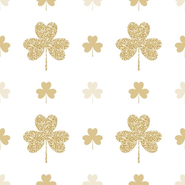 白い背景の上の黄金のシャムロックと幾何学的なシームレスパターン Premiumベクター