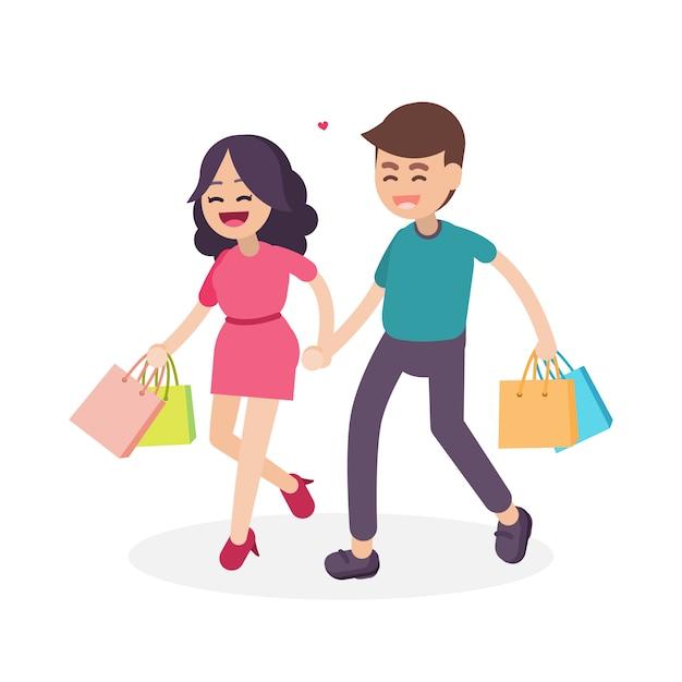 カラフルな買い物袋との幸せなカップル Premiumベクター