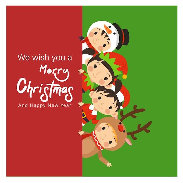 クリスマスキャラクターの衣装の若い子供たち Premiumベクター