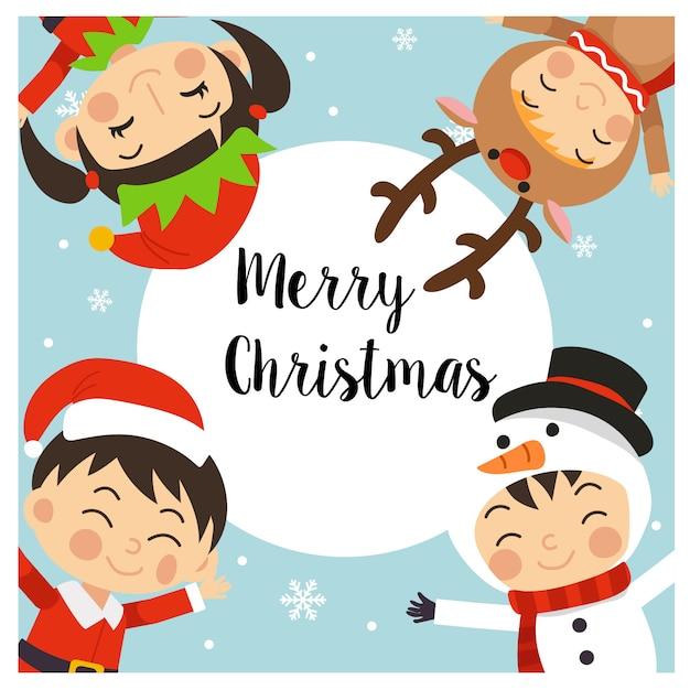 クリスマスの衣装で子供たちとメリークリスマスのグリーティングカード Premiumベクター