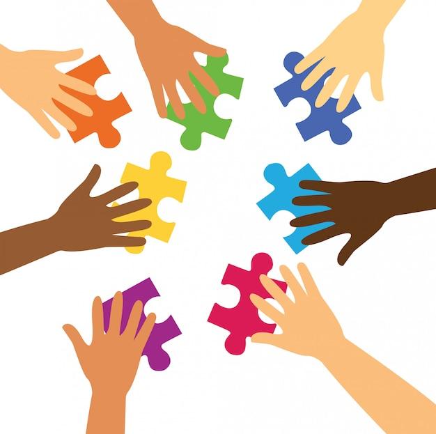 Многие руки держат красочные кусочки головоломки Premium векторы