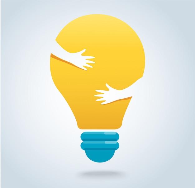 手は電球のアイコンベクトルを抱擁します。 Premiumベクター
