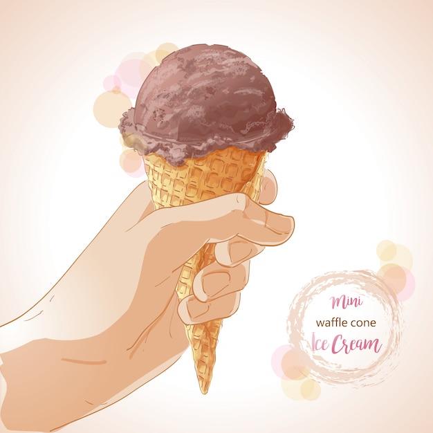ワッフルコーンにアイスクリームを持っているベクトル手 Premiumベクター