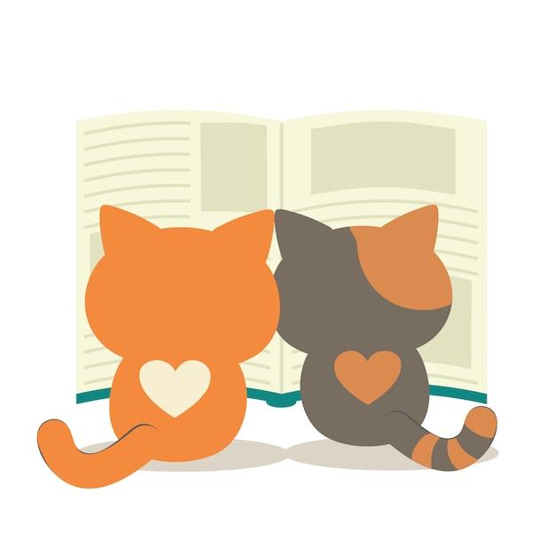 大きな本を読んでいる双子の猫。本と猫のかわいいキャラクター。 Premiumベクター