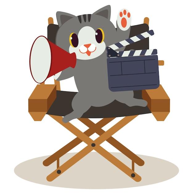 ディレクターチェアに座っているかわいい猫。猫は映画を作っています、そしてそれはとても幸せです。かわいい猫は監督として働いています。平らなベクトルスタイルのかわいい猫 Premiumベクター