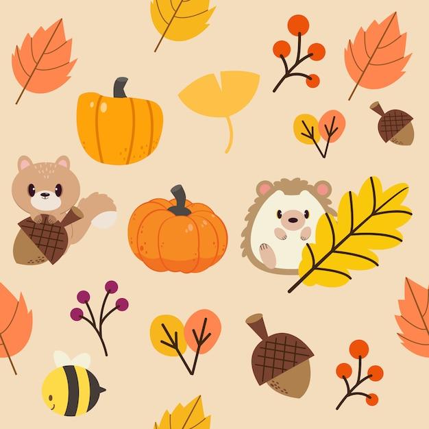 Узор из осенних листьев и диких животных. узор из листьев оранжевого и желтого тона. Premium векторы
