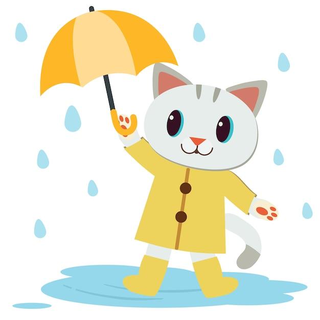 かわいい猫のキャラクターは、黄色いレインコートとブーツを着て、傘をさしています。 Premiumベクター