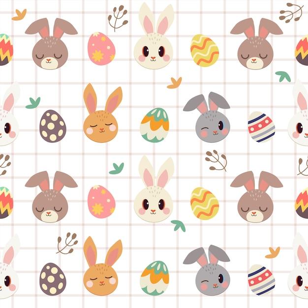 かわいいウサギとイースターエッグと葉のシームレスパターン Premiumベクター