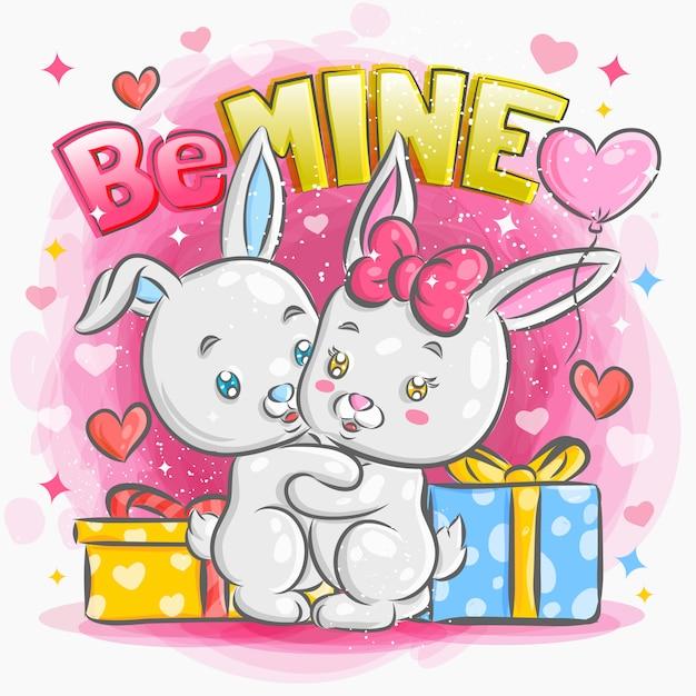 バレンタインのイラストで恋に感じているかわいいウサギのカップル Premiumベクター