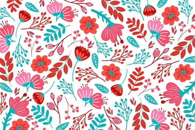 赤の色調で手描き花柄 無料ベクター