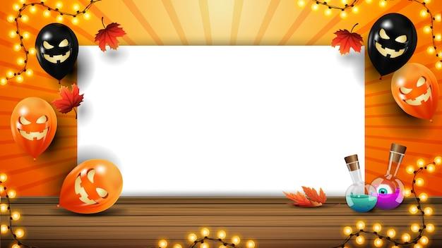 コピースペース、ハロウィーンバルーン、ガーランドとあなたの芸術のハロウィーンテンプレート。紙のシートとテキストのオレンジ色のテンプレート Premiumベクター