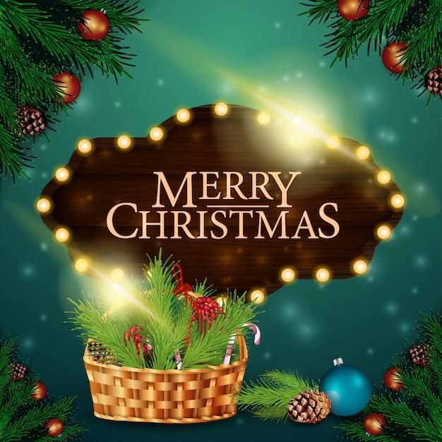 木製のサインとクリスマスバスケットのクリスマスカード Premiumベクター