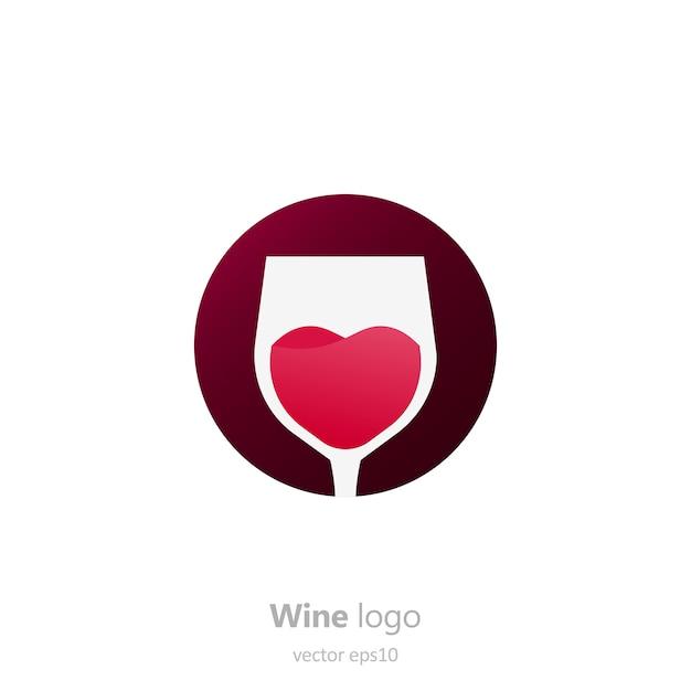 ワインのグラスと丸いロゴのセットです。動きのある液体でカプセル化します。 無料ベクター